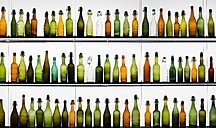 Three rows of different beer bottles - WGF000837