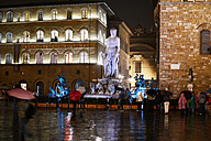 taly, Florence, tourists watching neptune fountain on rainy evening - KLR000278