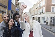 Group of happy friends taking a selfie on urban street - BOYF000173