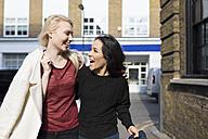 Two female best friends having fun on urban street - BOYF000191