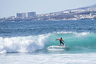 Spain, Tenerife, boy surfing on wave - SIPF000252