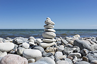 Stack of pebbles on stony beach - OJF000132