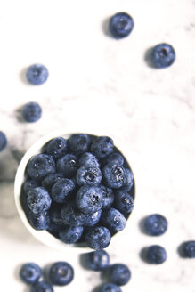 Bowl of blueberries on white marble - RTBF000002