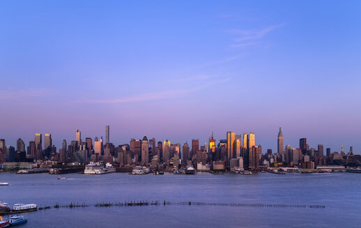 USA, New York City, view to Midtown Manhattan at dusk - HSIF000428