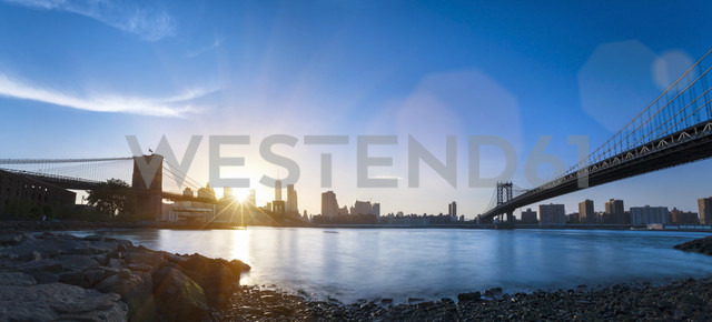 USA, New York City, Manhattan, panorama of financial district at sunset - HSIF000434