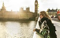 UK, London, young woman on Westminster Bridge - MGOF001549
