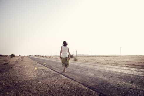 Man travelling alone on country road - BMAF000121