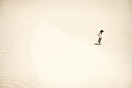 Man standing alone in the desert - BMAF000139