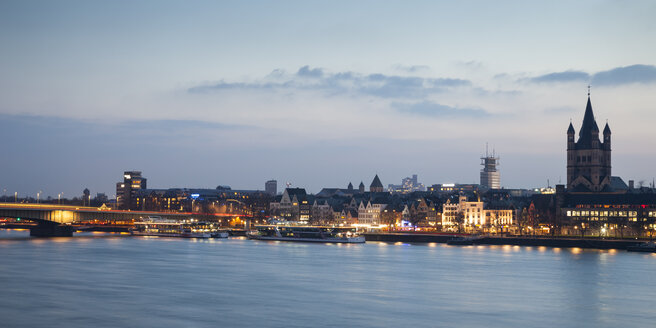 Germany, Cologne, view to the old town with Gross Sankt Martin at blue hour - WIF003291