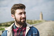 Spain, A Coruna, portrait of young man with brown hair and full beard - RAEF000943