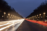 Germany, Berlin, view to Brandenburger Tor, road traffic and light traces in the evening - ZMF000462
