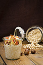Glasses of overnight oats with sliced apple, hazelnuts and cinnamon - LVF004656