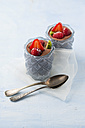 Glasses of Mousse au Chocolat garnished with raspberries, strawberries and hardy kiwi - MYF001409
