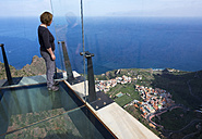 Spain, Canary Islands, La Gomera, Agulo, Mirador de Abrante, woman standing on skywalk - SIE006989