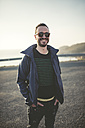 Portrait of smiling man with sunglasses - RAEF000951