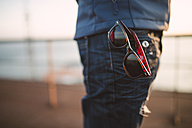 Sunglasses hanging out of trouser pocket - RAEF000954