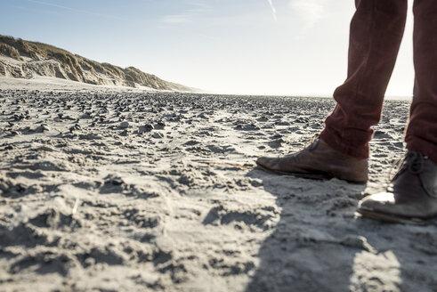 Denmark, Henne Strand, man standing on beach - BMAF000154