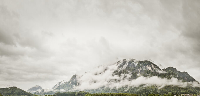 Austria, Anif, Mountainside in foggy weather - BMA000220