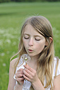 Portrait of girl blowing blowball - CRF002746