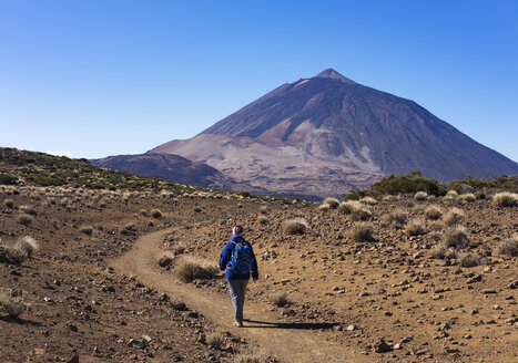 Spain, Canary Islands, Tenerife, Roques de Garcia, Mount Teide, Teide National Park, Female hiker on hiking trail Ruta Arenas Negras - SIEF007002