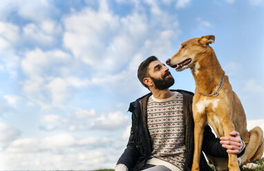 Portrait of happy man with his dog - MGOF001613