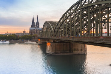Germany, Cologne, view to Cologne Cathedral with Hohenzollern Bridge in the foreground - TAMF000413