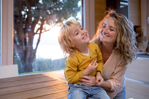 Mother playing with her little son at home - ZOCF000021