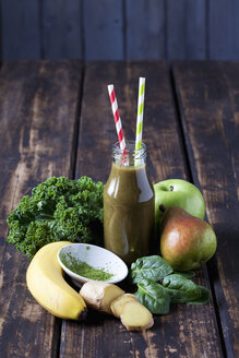 Ingredients for healthy vegetables and fruit smoothie on dark wood - CSF027367