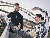 Germany, Cologne, Young couple worming up for workout - MADF000860