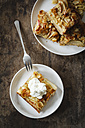 Piece of whole meal apple pie with sliced almonds and whipped cream - EVGF002865