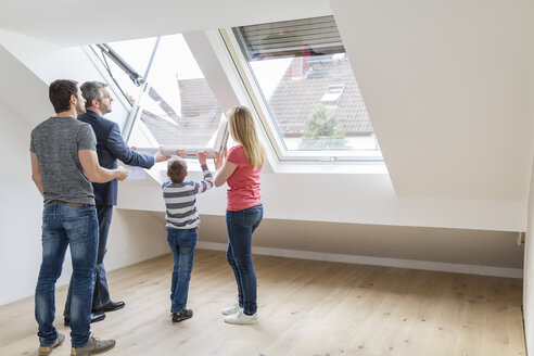Family and estate agent opening rooflight - SHKF000526