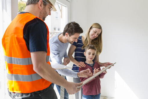 Construction worker showing family tile samples - SHKF000550
