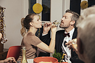 Couple drinking to close friendship on New Year's Eve - MFF002930