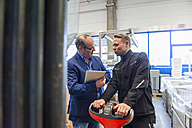 Manager and warehouseman dicussing logistics in storage - DIGF000163