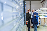 Manager and warehouseman dicussing logistics in storage - DIGF000169