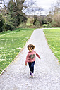 Little girl running in a park - MGOF001647