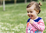 Little girl with braids sticking out tongue - MGO001650