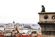 Hungary, Budapest, woman looking on the Parliament Building from Castle Hill - GEMF000813