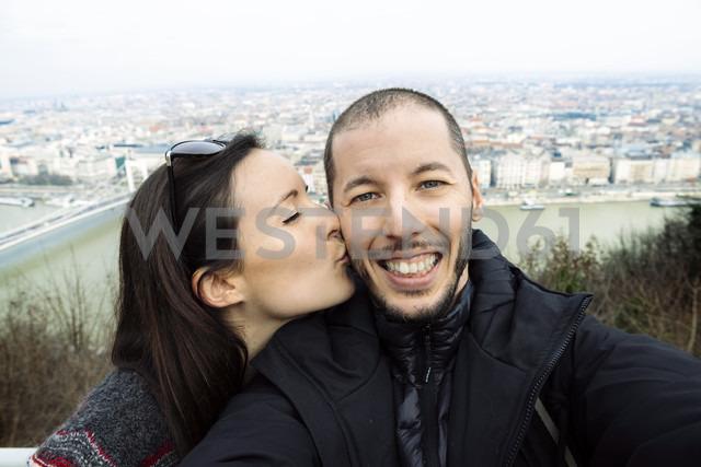 Hungary, Budapest, woman kissing man on Gellert Hill - GEMF000816