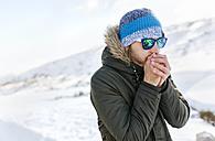 Spain, Asturias, freezing man in snowy mountains - MGOF001658