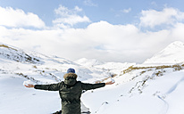 Spain, Asturias, man in snowy mountains - MGOF001661