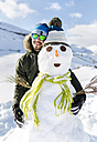 Spain, Asturias, happy young man with a snowman - MGOF001670