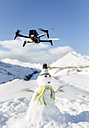 Spain, Asturias, drone flying in snowy mountains - MGOF001676