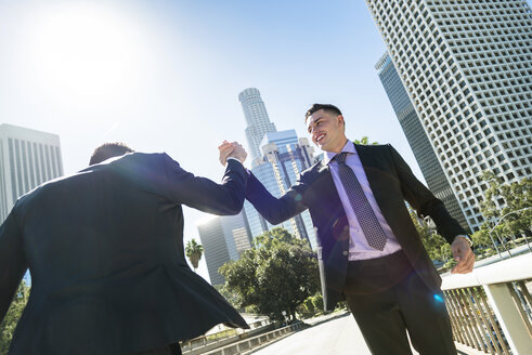 USA, Los Angeles, two businessmen high fiving - LEF000021