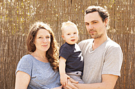 Portrait of smiling family of three - MFRF000504