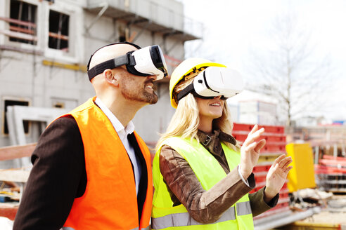 Two persons with Virtual Reality Glasses at construction site - MAEF011437
