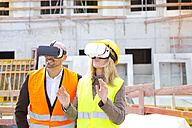 Two persons with Virtual Reality Glasses at construction site - MAEF011440