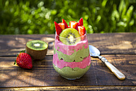 Glass of chia pudding with kiwi and strawberries - SARF002665