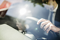 Close-up of businessman in car - LEF000040