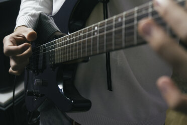 Guitar player rehearsing for performance, close up - ABZF000315